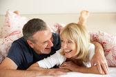 Senior Couple Relaxing Together In Bed — Stock Photo