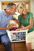 Senior Couple Sorting Laundry Together — Stock Photo