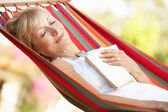Senior Woman Relaxing In Hammock — Stock Photo