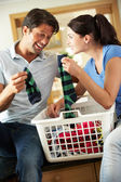 Couple Sorting Laundry In Kitchen — Stock Photo
