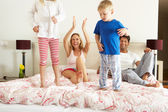 Family Relaxing Together In Bed — Stock Photo