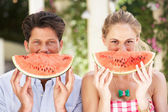 Couple Enjoying Slices Of Water Melon — Stock Photo