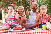 Group Of Children Eating Jelly And Cake At Outdoor Tea Party — Stock Photo