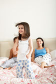 Family Bouncing On Bed Together — Stock Photo