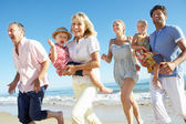 Multi Generation Family Enjoying Beach Holiday — Stock Photo