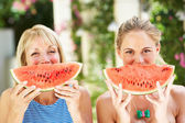 Mother And Adult Daughter Enjoying Slices Of Water Melon — Stock Photo