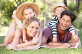 Family Relaxing In Park Together — Stock Photo