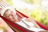 Senior Woman Relaxing In Hammock — Stock Photo