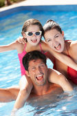 Family Having Fun In Swimming Pool — Foto de Stock