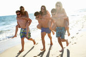 Group Of Teenage Friends Enjoying Beach Holiday Together — Stock Photo