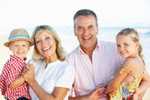 Grandparents And Grandchildren Enjoying Beach Holiday — Stock Photo