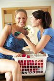 Two Women Sorting Laundry In Kitchen — Stock Photo