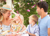 Family Enjoying Meal outdoorss — Stock Photo