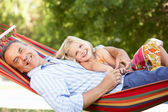 Grandfather And Granddaughter Relaxing In Hammock — Stock Photo
