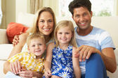 Family Relaxing On Sofa At Home — Foto Stock