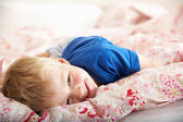 Young Boy Relaxing On Bed — Stock Photo