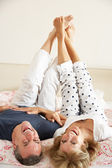 Senior Couple Lying Upside Down Together In Bed — Stock Photo