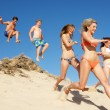 Stock Photo: Group Of Teenage Friends Enjoying Beach Holiday Together