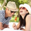 Couple Relaxing Together In Garden Eating Ice Lolly — Stock Photo