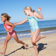 Stock Photo: Three Children Running Along Beach