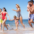 Multi Generation Family Enjoying Beach Holiday — Stock Photo #24640215