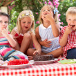 Royalty-Free Stock Photo: Group Of Children Eating Jelly And Cake At Outdoor Tea Party