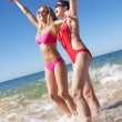 Two Women Enjoying Beach Holiday — Stock Photo #24640257