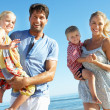 Stock Photo: Family Having Fun On Beach