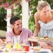 Stock Photo: Group Of Friends Enjoying Meal outdoorss