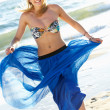 Stock Photo: Teenage Girl Wearing Sarong On Beach Holiday