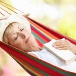 Senior Woman Relaxing In Hammock — Stock Photo #24640381
