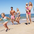 Multi Generation Family Enjoying Beach Holiday — Foto de stock #24640423