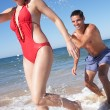 Couple Enjoying Beach Holiday — Stock Photo #24640449