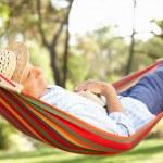 Senior Man Relaxing In Hammock — Stock Photo #24640451