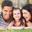 Family Relaxing In Summer Garden — Stock Photo #24640469