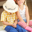 Two Children Sitting Outside House — Stock Photo