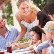 Stock Photo: Woman Serving At Multi Generation Family Meal