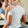 Romantic Couple Hugging In Kitchen — Stock Photo #24640581