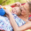 Stock Photo: Mother And Son Relaxing In Hammock