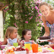 Mother Serving Birthday Cake To Group Of Children Outdoors — Stock Photo