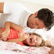 Father And Daughter Relaxing Together In Bed — Stockfoto