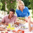 Group Of Young And Senior Couples Enjoying Family Meal — Stock Photo #24640647