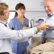 Doctor Examining Male Patient With Elbow Pain — Stock Photo #24644733