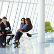 Businesspeople Having Meeting In Modern Office — Stock Photo #24644803