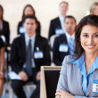 Businesswoman Delivering Presentation At Conference — Stock Photo #24644889