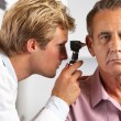 Stock Photo: Doctor Examining Male Patient's Ears
