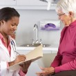 Doctor Examining Senior Female Patient — Stock Photo