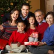 Multi Generation Family Opening Christmas Presents In Front Of T — Foto de Stock