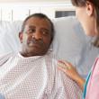 Nurse Talking To Senior Male Patient On Ward — Stock Photo #24645569