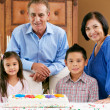 Grandparents Celebrating Children's Birthday - Stock Photo
